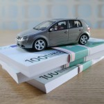 Toy Car on Stack of Euro Bills